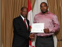St. Kitts and Nevis' Prime Minister, the Right Hon. Dr. Denzil L. Douglas (left) presenting the Entrepreneurship Award to Mr. Kenneth Liburd Jr.