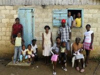 Sentilia Igsema (2nd R, seated), born in 1930 in the Dominican Republic to Haitian immigrants, poses with four generations of her family outside their home in Batey La Higuera, in the eastern Seibo province, October 7, 2013. REUTERS/Ricardo Rojas