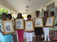 Relatives of Alice Nisbett, Celian Powell, Selena Ward, Jane Canning and Herman Ward display self portraits donated to the seniors by the NIA's Ministry of Social Development