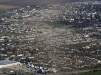 An aerial view shows the path of destruction caused by a tornado that touched down in Washington, Illinois, November 18, 2013. REUTERS/Jim Young