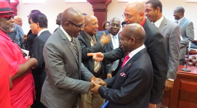 Photo 1 – St. Kitts and Nevis' Prime Minister and Minister of Finance, the Right Hon. Dr. Denzil L. Douglas (right) is congratulated by the President of the St. Kitts and Nevis Chamber of Industry and Commerce, Mr. David Lake.