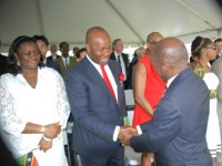 Photo shows St. Kitts and Nevis' Prime Minister the Rt. Hon. Dr. Denzil L. Douglas (right) greeting Akwa Ibom Governor, His Excellency Chief Godswill Akpabio and Mrs. Akpabio at St. Kitts and Nevis' Ceremonial Parade to mark the Federation's 30th Anniversary of Independence. (Photo by Erasmus Williams)