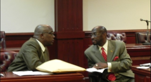 File photo of Dr. the Hon. Timothy Harris (left) and the Hon. Sam Condor, then Ministers of Government sitting in the National Assembly.