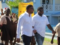 Deputy Premier of Nevis and Minister of Health Hon. Mark Brantley (left) marching with colleague Minister Hon. Troy Liburd and students in observance of World AIDS Day 2013