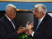 Jamaica's Minister of Foreign Affairs and Foreign Trade, Senator A.J. Nicholson (left), and his Trinidad and Tobago counterpart, Winston Dookeran, in discussion prior to the start of a meeting in Kingston on December 2 to discuss issues of free movement and free trade within the context of the Caribbean Single Market and Economy (CSME). JIS photo