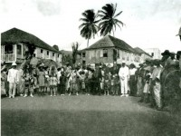 : Photo of Masqueraders in front of the Paragon Pharmacy