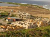Imperial Bay St. Kitts Golf & Beach Residences under construction at Half Moon Bay. The cleared land in the background is the site for the Koi Resort & Residences.