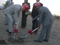 Ambassador Barfod (left) and PM Douglas turn the sod at the site for the new Multipurpose Security Training Center while Governor General His Excellency Sir Edmund Lawrence (back right) looks on.
