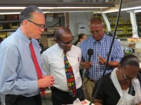 (left to right) - General Manager and Head of Global Operations at API's World Headquarters, Mr. Kevin Heffler; St. Kitts and Nevis' Prime Minister the Right Hon. Dr. Denzil L. Douglas and Plant Manager, Mr. Carol Evelyn tour the Harowe Servo Plant in Sandy Point, St. Kitts.