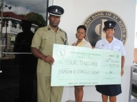 Superintendent Cromwell Henry displays the sponsorship cheque. With him are Development Bank's Manager for Marketing and Product Development Ms Danienne Brin (centre) and Sergeant Carlene Phipps.