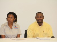 (L-R) Donna Pierre, Mitigation and Preparedness Specialist, and workshop facilitator from the Caribbean Disaster Emergency Management Agency and Brian Dyer Project Officer at the Nevis Disaster Management Department at the opening ceremony for the Kitts and Nevis National Tsunami Adaptation Workshop at Long Point on February 19, 2014