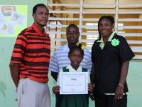 gnacio Ottley Vice President the Four Seasons Five Diamond Sports and Social Club, Club President Lavorn Lawrence and  Mrs. Janice Richards Principal of the Ivor Walters Primary School with the Four Seasons Five Diamond Sports and Social Club scholarship recipient Charisma Kelly