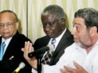 Prime Minister Dr. ralph Gonsalves (right) falnked by his Barbados counterpart Freundel Stuart (center) and Chairman Jean Holder