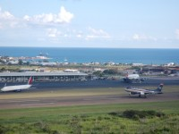 Photo shows a US Airways aircraft taking off from St. Kitts' Robert L. Bradshaw International Airport. (Photo by Erasmus Williams)