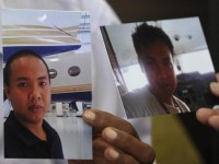 Pictures of flight engineer Mohd Khairul Amri Selamat who was onboard the missing Malaysia Airlines Flight MH370, are seen in Putrajaya March 16, 2014. Malaysian police are investigating the aviation engineer who was among the passengers on the missing Malaysia Airlines plane as they focus on the pilots and anyone else on board who had technical flying knowledge, a senior police official said. Khairul, 29, a Malaysian who has said on social media he had worked for a private jet charter company. Picture taken March 16, 2014.    REUTERS/Stringer (MALAYSIA - Tags: DISASTER TRANSPORT)