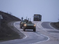 Russian military armoured personnel carriers (APC) drive on the road from Sevastopol to Simferopol March 4, 2014.  REUTERS/Baz Ratner (UKRAINE - Tags: MILITARY POLITICS)