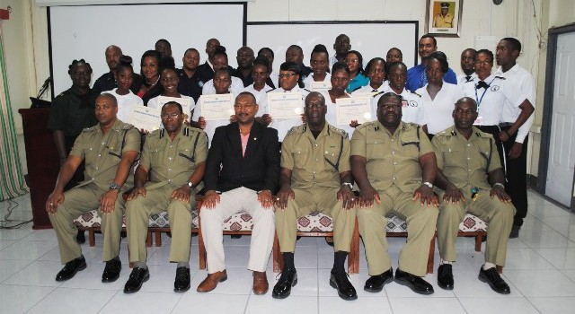 Successful Island Constables pose for a group picture with their superiors, front row from left: Inspector Eldrin Dickenson, Police Force Chaplain Superintendent Pastor Leroy Benjamin, Assistant Commissioner of Police Ian Queeley, Commissioner of Police Dr Celvin G. Walwyn, Superintendent Lionel Moore, and Superintendent Cromwell Henry.