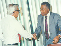 In this 1987 photo from Guardian's archives, then prime minister ANR Robinson shakes hands with Basdeo Panday who was a member of his NAR Cabine