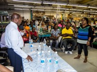 Prime Minster Denzil Douglas has a heart-to-heart discussion with workers at electronic manufacturing company Jaro.