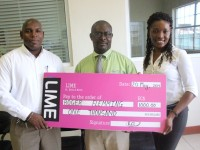 LIME: Handing over cheque to Mr. Roger Flemming and Ms. Arlene Flemming
