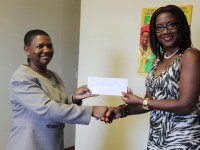 Vice President of the Nevis Association of South Florida Avonelle Hanley (right) officially handing over a check to the Principal Education Officer in the Department of Education Palsy Wilkin at a handing over ceremony at the Department of Education of May 20, 2014