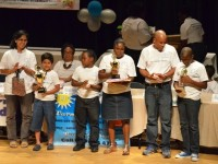 Winners of the 5th annual Warner's One Stop Family Book Feud (l-R) first place Mamata and Hrishikesh Shrinivasan of the Montessori Academy, second place Veron and Steve Walters of the Elizabeth Pemberton Primary School and third place Stephen and Renado Hanley of the Charleston Secondary School