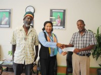 Mr Franklyn Daniel, President of Nevis Masters Cricket Club (right) receives sponsorship cheque from Mrs Jean Alcendor-Browne, the Bank's Credit Risk Management Officer in the Nevis Branch. Looking on is Mr Leroy 'Blackman' Liburd, Member Management Committee.