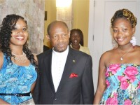 Ms Zanya Wilkinson (left) and Ms Victoria Newton with Prime Minister the Rt Hon Dr Denzil Douglas