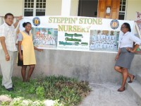 The PEP connection: Mrs Patricia Dasent (right) with PEP field Officer Mr Floris Finley and PEP worker at Steppin' Stone Phase Two, Ms Victoria Newton.
