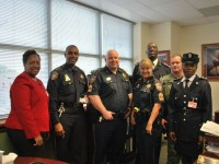 Commissioner Walwyn (back row) along with Inspector Roberts (right) and consultant A.D. Walwyn (left) with members of the Harris County Sherriff's Office