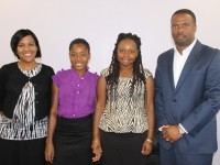 (l-r) Permanent Secretary in the Ministry of Health Nicole Slack-Liburd, recipients for the Medical University of the Americas/Nevis Island Administration Health Science Scholarship Brendlyn Fyfield and Shaniece Jones and Deputy Premier and Minister of Health in the Nevis Island Administration Hon. Mark Brantley