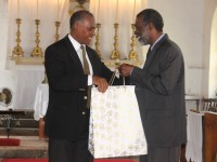 Premier of Nevis Hon. Vance Amory (left) presents Organisation of American States outgoing Ambassador to St. Kitts and Nevis His Excellency Starret Greene with a token of appreciation on behalf of the Government and people of Nevis at a special church service held in his honour at the St. Paul's Anglican Church in Charlestown on June 18, 2014