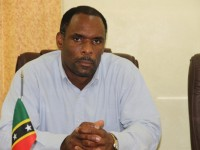Permanent Secretary in the Ministry of Finance on Nevis Colin Dore at a handing over ceremony at the Ministry of Finance conference room on Nevis on June 24, 2014