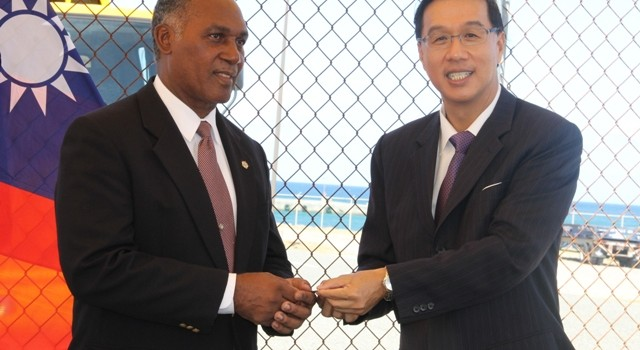 Republic of China (Taiwan)'s Resident Ambassador to St. Kitts and Nevis His Excellency Miguel Tsao handing over the keys of a refuse disposal truck for use by the Nevis Solid Waste Management Authority to Premier of Nevis Hon. Vance Amory at a ceremony at Long Point on July 21, 2014