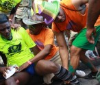 Dr. Wilson and Dr. Gilbert giving assistance to the male reveller injured durng J'Ouvert. (Photo by Erasmus Williams)