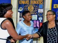 Permanent Secretary in the Ministry of Justice and Chair of the National Task Force Against Trafficking in Persons, Carol Palmer (right), is introduced to Secretary for the Kiwanis Club of New Kingston, Sacha Vacianna Riley (left), by Club President, Rosemarie Henry, prior to the start of a human trafficking seminar, hosted by the Club on July 16, at the offices of the Institute of Chartered Accountants of Jamaica in Kingston.