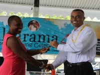 Ernie France, Managing Director of St. Kitts-Nevis- Anguilla Trading and Development Company (TDC Nevis Ltd.) officially handing over the keys to a red Toyota Yaris, valued at EC$80,000, to Culturama 40 Central Committee Chair Deborah Tyrell at a Culturama press briefing hosted at the Riviere House on Government Road on July 09, 2014. The car is a prize to be awarded to the winner of the 2014 Senior Kaiso Competition