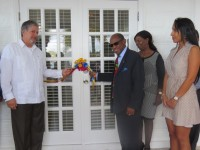 St. Kitts and Nevis' Prime Minister the Rt. Hon. Dr. Denzil L. Douglas (right) and Venezuela's Resident Ambassador, His Excellency Rómulo Camilo Henríquez González cutting the ribbon to open the new Embassy of Venezuela