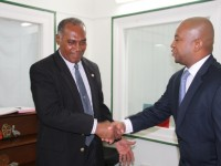 L-R) Premier of Nevis Hon. Vance Amory welcoming new Organization of American States Representative to St. Kitts and Nevis His Excellency Terence Raymond Craig to his Bath Plain Office on August 21, 2014