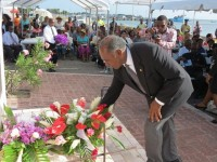 Premier of Nevis Hon. Vance Amory lays a wreath on behalf of the Nevis Island Administration at the Christena Disaster Memorial on the Charlestown Waterfront, during a memorial service to mark the 44th anniversary of the tragic event which claimed 233 lives