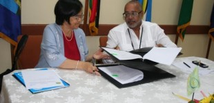OECS Commission's Director General Mr. Didacus Jules and the UNICEF Representative Ms. Khin-Sandi Lwin.