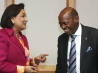 Prime Minister of Trinidad and Tobago Kamla Persad-Bissessar (L) speaks with Prime Minister of St Kitts and Nevis Dr Denzil Douglas at the Caribbean Community (Caricom)/Japan summit, in Port-of-Spain, on July 28, 2014. REUTERS/Andrea De Silva (TRINIDAD AND TOBAGO - Tags: POLITICS)