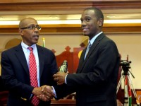 Deputy Prime Minister and Minister of Housing, Energy and Public Works and Parliamentary Representative for St. Christopher 1 (East Basseterre), the Hon. Dr. Earl Asim Martin presents Award to Mr. Ajamu King.