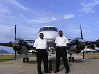 VI Airlink Pilots Mr. Norville Brathwaite (left) and Mr. Neville Brathwaite Junior.