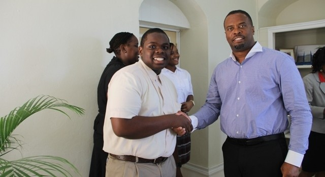 Deputy Premier of Nevis and Minister of Tourism Hon. Mark Brantley gives his blessings reigning Junior Minister of Tourism on Nevis Rol-J Williams, who is Nevis' representative in the 2014 CTO Tourism Youth Congress