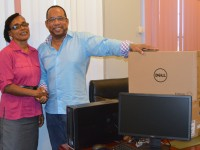 Mrs. Lineth Williams, Deputy Principal of the Gingerland Secondary School receives Dell Computers from Attorney and Businessman, Gregory Hardtman