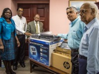 SKNIS Photo:  Permanent Secretary of the Anti Crime Unit Astona Browne (left) and PM Douglas (3rd from left) with donation from Office World represented by Naresh Daryanani (2nd right) and other company officials.