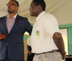 Hon. Mark Brantley, Deputy Premier and Minister of Tourism in the Nevis Island Administration congratulates Rol-J Williams, the newest Caribbean Junior Tourism Minister at his school in Gingerland