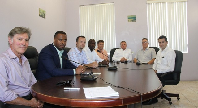 (L-R) Derya Yavalar, Hon. Mark Brantley Deputy Premier of Nevis and Minister of Health, Chris Burgess Chief Operations Officer of Omni Alpha, Engineer Marcelleus Butler, Edward Yealdhall, Recycle Manager Steve Hammond, David Johnson and Russel Marsh of Fulton Bank at the Nevis Island Administration conference room on September 24, 2014