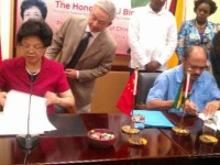 China's Health Minister, Li Bin and Guyana's Health Minister, Dr Bheri Ramsaran sign the MOU for the Medical House of Science.